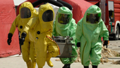men in protective bioterrorism suits