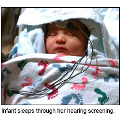 Infant sleeps through her hearing screening.