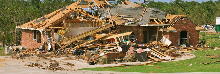 The aftermath of a tornado that destroyed a house.
