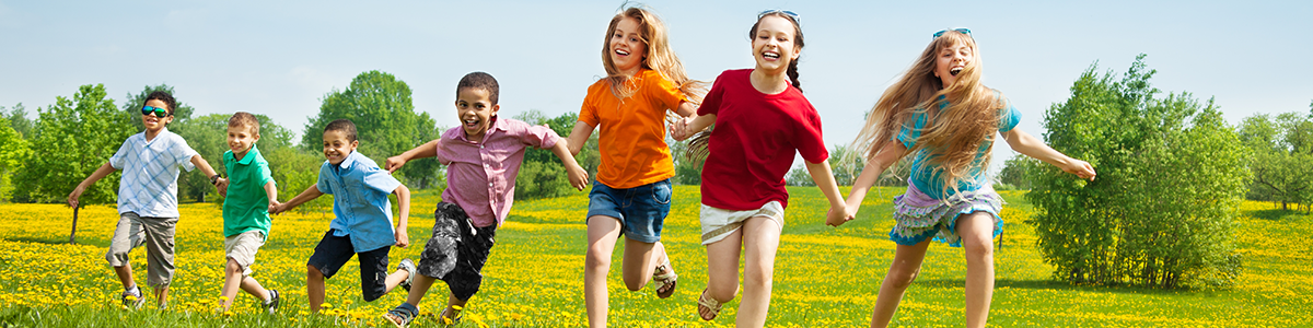 Children running through a field