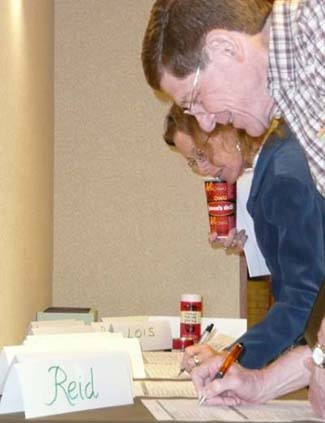 Photo of Don Wilson and Margaret Drummond-Borg signing in at the start of the TNSPMP meetings