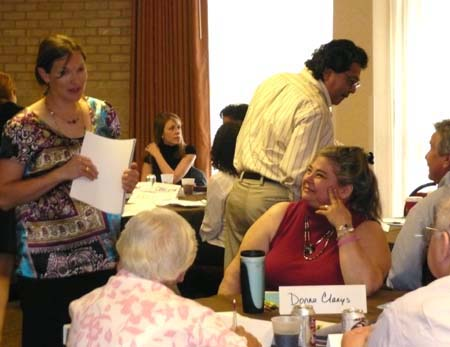 Photo of Susan Tanksley talking with Donna Claeys, Sister Mary Nicholas, and Jerald Zarin