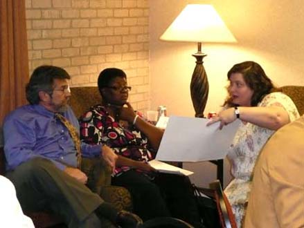 Photo of Susan Hoffpauir explaining Newborn Screening submission form to Jose Gonzalez and Daisy Johnson