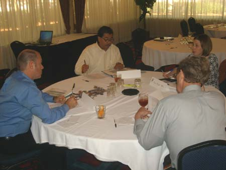 Photo of TNSPMP team members in discussion