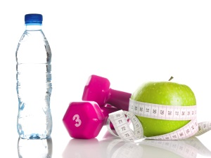 Posed water, weights, and an apple